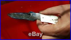 Custom Bill Coffey folding knife mother of pearl gem stones damascus