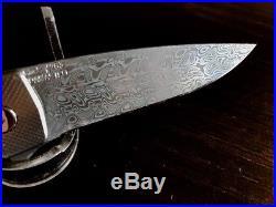 Grimsmo Rask Folding knife #283, Damascus Blade, DLC Silver Ti hancle