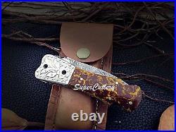 Hand forged Damascus folding knife Resin Brown sheet Engraved bolster pocket