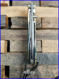 Higgins and Peak Mammoth Tooth Handled Damascus Folding Knife
