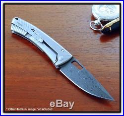 LIONSTEEL TiSpine Damascus/Titanium Framelock Fold Knife. 3.35 blade. TS1DR GM