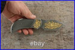 Premium Custom Author's folding Damascus knife decorated with gold Taiga