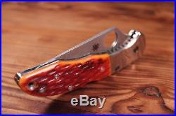 Spyderco C11JBOP Delica Folding Knife Damascus Blade, Orange Jigged Bone Handles