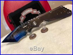 Strider Custom XL San Mai Damascus tanto folding knife