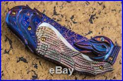 Suchat Jangtanong Custom Folding Knife Color Damascus Steel Carved as Swan Topaz