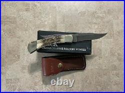 Vintage Buck Knives 110 Folding Hunter Stag Damascus Knife