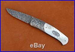 W. E. Ankrom Liner Lock Folding Knife. Damascus Blade. James Blair Engraving